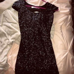 Black tight sparkly dress with a cut out back